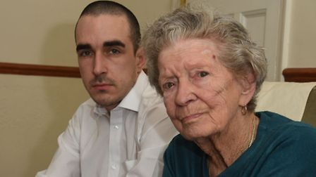 An 89 year old grandmother was mugged outside of her house in Ilford. Pictured with her grandson.