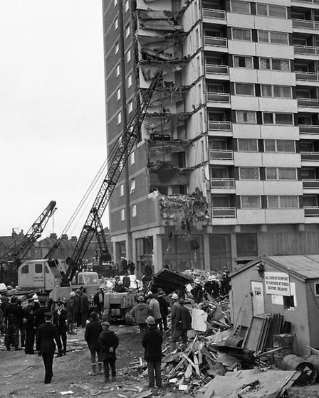 Rescue workers search debris after the collapse of a complete corner of Ronan Point, a 22 storey blo