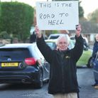 Frank Nicholls along with other residents hands over a petition to Suffolk Cllr Sonia Barker to improve the traffic...