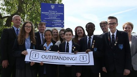 Redden Court staff and students celebrating an 'outstanding' Oftsed report in 2014.