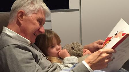 Nick Butterworth reading to his granddaughter Cleo