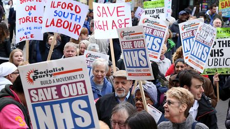 Protestors hold signs at a march to save King George Hospital's A&E, on 18th March 2017. Picture: Ca