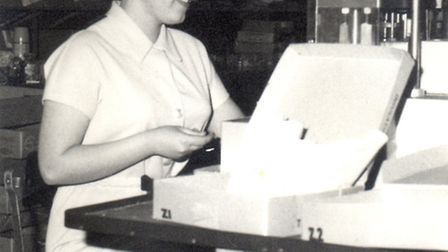 A worker at Whitefield�'s sweet factory, Tunmarsh Lane, Plaistow, c.1960. Picture: Eastside Communit