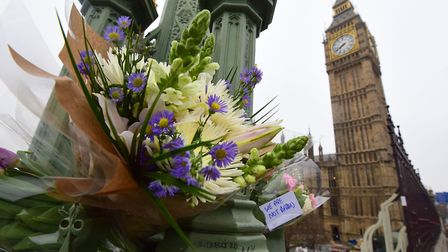 Flowers left on Westminster Bridge in central London following the terrorist attack on Wednesday (Pi