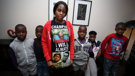 The mother of teenage stab victim Champion Ganda, Peguy Kato with her children, Bernoulli, Prince a