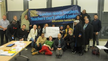 Keyworkers - including teachers and nurses - gather for a meeting to discuss One Housing Group's 40