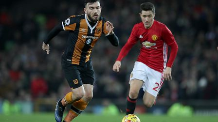Hull City's Robert Snodgrass (left) and Manchester United's Ander Herrera (right) battle for the bal