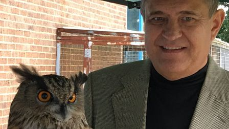 An owl with Mark Glazer. The birds have no direct involvement with the new technology.