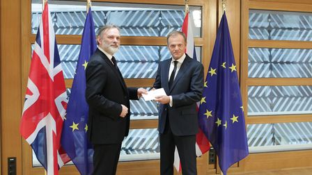 Britain's ambassador to the European Union, Sir Tim Barrow hands Theresa May's Brexit letter to EU C
