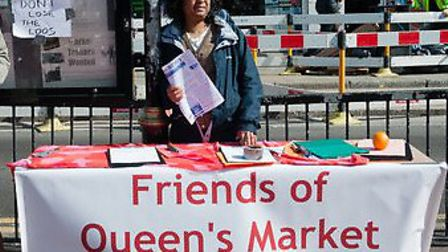 A campaigner from Queen's Market petitioning against the possible closure of public toilets near the