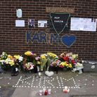 Floral tributes for Karim Samms who was shot and killed in North Woolwich