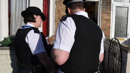 Police officers on a housing raid in Newham