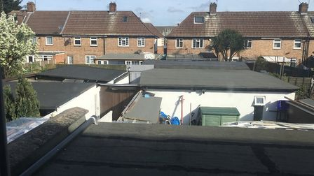 Outbuildings pictured from inside a house during a raid by Newham Council officers and police. Pictu