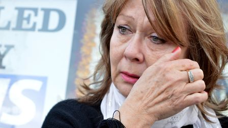Victor's sister Angela Farrugia wipes away a tear as she arrives at a demonstration over the contami