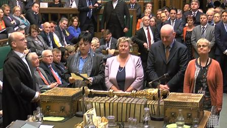 Tellers approach the speaker to announce the result of a vote by MPs in the House of Commons as they