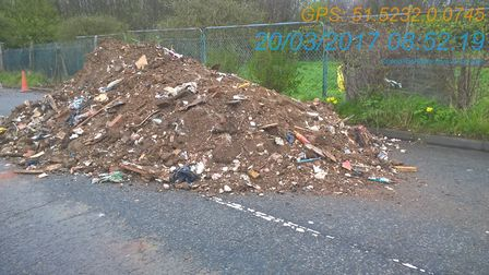 Beattie dumped 36 tonnes of asbestos-contaminated rubble on a street in Beckton. Picture NEWHAM COU