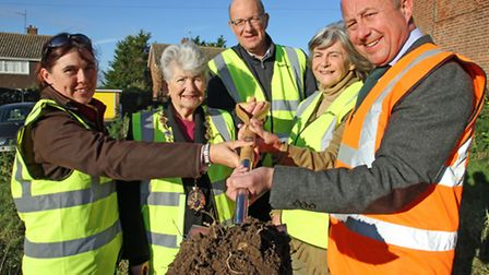 Cutting the first sod at the site of new affordable homes at Southwold are (from left): Isobel Wrigh