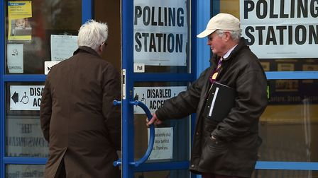 Voters arrive at a polling station. Picture: Joe Giddens/PA Wire/PA Images.
