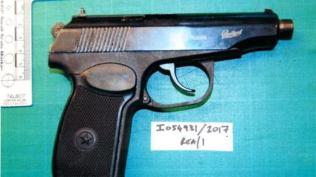 Walid Adam tried to throw away his illegal pistol while being chased by police