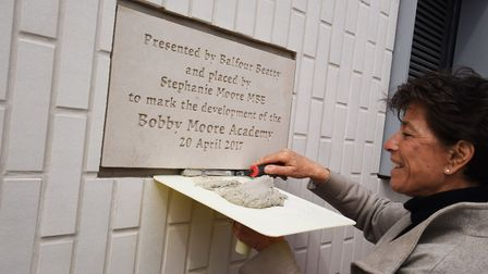 Stephanie Moore cements a plaque to mark her visit