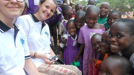 Crownfield Infant School teaching assistant Daisy Lewis with children in Uganda. Picture: Crownfield