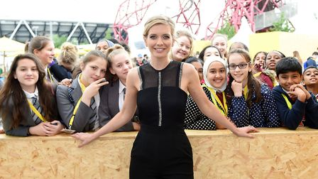 Television presenter Rachel Riley poses with students during Make the Future London 2016 at Queen El
