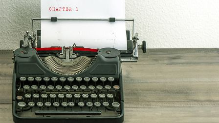 typewriter with white paper page