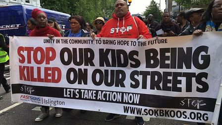 Stefan Brown, centre, heads the Stop Our Kids From Being Killed On Our Streets charity spoke at the