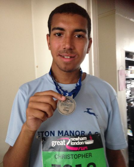 Chris Reid shows off his Great Newham Run medal in 2016