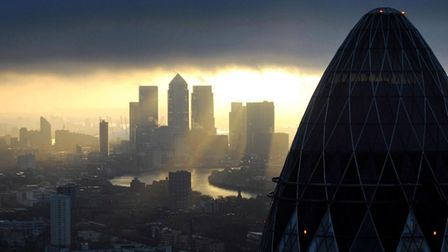 Canary Wharf at sunrise in London. Photograph: Stefan Rousseau/PA.
