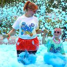 A mum and daughter run through the bubbles at the Bubble Rush 5km run yesterday. Picture: Catherine