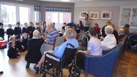 YOUNG AND OLD: Neighbours become good friends at new Lowestoft care home. Pupils from Roman Hill Pri
