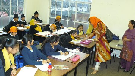 Students study Panjabi during a class at the Ramgarhia School which celebrates its 35th anniversary