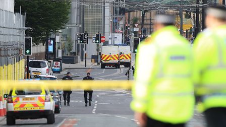 Police close to the Manchester Arena the morning after a suspected terrorist attack at the end of a