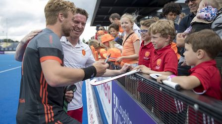 England's Michael Hoare and Dutch rival Mink van der Weerden sign autographs for young fans after th