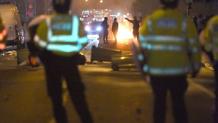 Bins were set on fire in Forest Gate last night (Picture: Lauren Hurley/PA Wire)