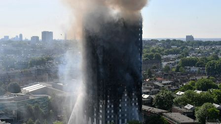 Smoke billows from a fire that has engulfed the 24-storey Grenfell Tower in west London. Picture: PA
