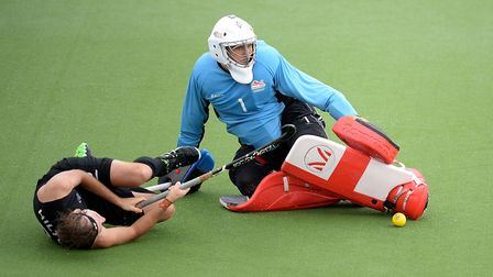 England's George Pinner makes a save from New Zealand's Blair Hilton at the 2014 Commonwealth Games