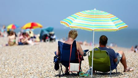 Heatwave advice includes staying in the shade where possible (Picture: Jonathan Brady/PA Wire)