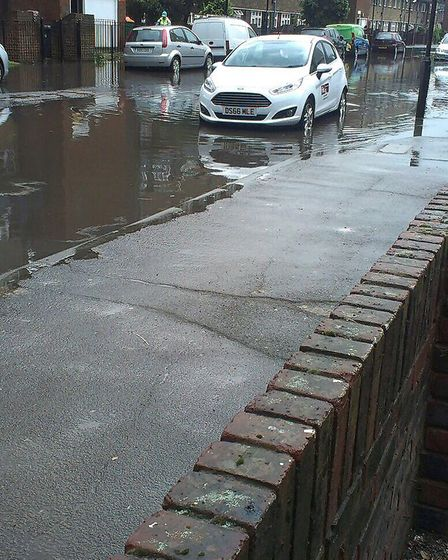 Flooding in Beaconsfield Road, Canning Town. Picture: TWITTER@loveofacaptain
