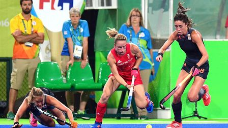 Susannah Townsend gets away from Netherlands duo Maartje Paumen and Naomi van As at the Rio Olympics