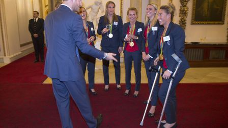 Prince Harry meets the GB women's hockey team, including Susannah Townsend on crutches after their O