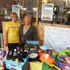 Staff Jean Lyons and Pauline Obee by the boarded up window at the Rainbow Charity Trust shop in Haro