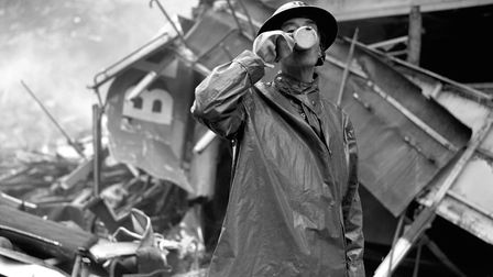 A fireman enjoys a refreshing cup of tea as he works to clear rubble caused by the bombing of London