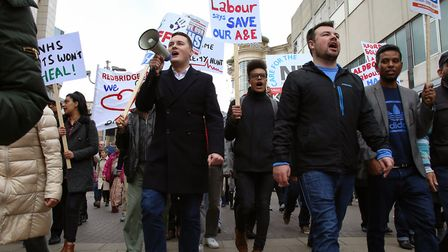 Ilford North Labour MP Wes Streeting leads the chant at a march to save King George Hospital's A&E,