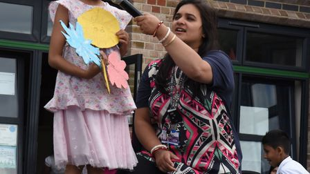 The Downshall Primary School fete and unity fair in full swing. Young poet Nana