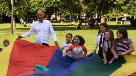 Teachers and families attending the Stand Up to School Cuts picnic on Christchurch Green in Wanstead