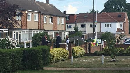 Officers guard the house in Blyth Walk, Upminster where a family were found dead. Picture: Ann-Marie