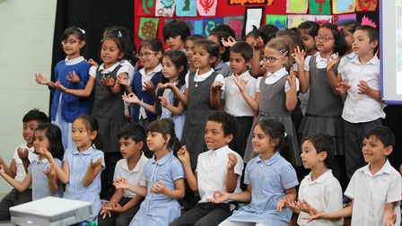 Newham pupils from Elmhurst Primary School singing their song 'Share your faith' Picture: RE Matters