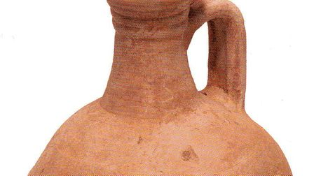 A Roman flagon found in what is believed to have been an early Roman cremation pit at Fairlop Quarry